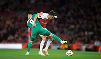 Mesut Özil of Arsenal battles Mykhaylo Serhiychuk of Vorskla Poltava during the UEFA Europa League match group between Arsenal and Vorskla Poltava at the Emirates Stadium, London, England on 20 September 2018. Photo by Andrew Aleks / PRiME Media Images.