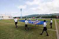 The CONCACAF fifty year anniversary flag is carried onto the field during the third place game of the CONCACAF Men's Under 17 Championship at Catherine Hall Stadium in Montego Bay, Jamaica. Panama defeated Jamaica, 1-0.