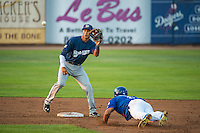 Carlos Belonis (2) of the Helena Brewers waits for the throw as a sliding Kelvin Ramos (8) of the Ogden Raptors attempts to steal second base in Pioneer League action at Lindquist Field on August 19, 2015 in Ogden, Utah.  Ogden defeated Helena 4-2. (Stephen Smith/Four Seam Images)