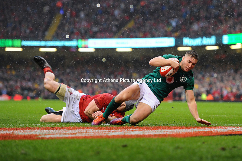 Pictured: Jordan Larmour of Ireland scores his sides first try during the Guinness six nations match between Wales and Ireland at the Principality Stadium, Cardiff, Wales, UK.<br /> Saturday 16 March 2019