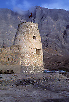 Bukha, Oman.  Bukha Fort in 1985, prior to restoration.  Al-Qala Tower on the hillside in the background, right.