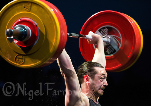10 MAY 2014 - COVENTRY, GBR - Mehmed Fikretov from the Crystal Palace Weightlifting Club attempts to hold a lift during the men's 77kg A category round at the British 2014 Senior Weightlifting Championships and final 2014 Commonwealth Games qualifying event round at the Ricoh Arena in Coventry, Great Britain (PHOTO COPYRIGHT © 2014 NIGEL FARROW, ALL RIGHTS RESERVED)