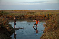Stiffkey, Norfolk, England, 07/08/2009..Children playing in Stiffkey salt marshes.
