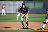 Vermont Lake Monsters Dustin Harris (21) leads off first base during a NY-Penn League game against the Aberdeen IronBirds on August 18, 2019 at Leidos Field at Ripken Stadium in Aberdeen, Maryland.  Vermont defeated Aberdeen 6-5.  (Mike Janes/Four Seam Images)