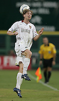 August 10, 2005: Westminster, MD, USA:  MetroStars midfielder Eddie Gaven (24) heads the ball while playing DC United at RFK Stadium.