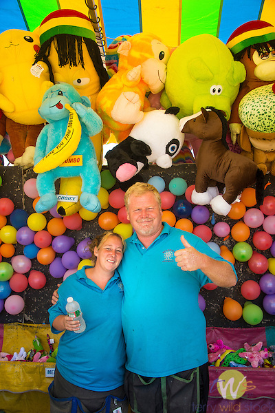 Guilford Fair. Husband and wife vendors at balloon game concession.