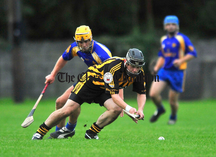 Brian Chambers of Ballyea gets to the ball ahead of Newmarket's Shane O' Brien. Photograph by Declan Monaghan