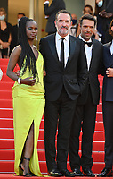 CANNES, FRANCE. July 17, 2021: Fatou N'Diaye, Jean Dujardin & Nicolas Bedos at the Closing Gala & Awards Ceremony, and From Africa With Love Premiere at the 74th Festival de Cannes.<br /> Picture: Paul Smith / Featureflash