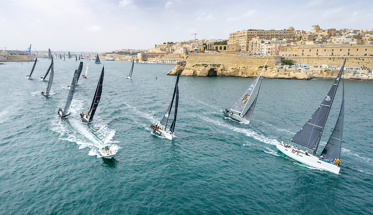 Conor Doyle's Kinsale XP 50 Freya (right) exits Valetta Harbour at the start of the 600-mile Rolex Middle Sea Race in Malta today