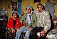 Tunisia, Le Kef.  Hammam Mellegue, Roman Era Baths.  Caretaker (middle), Wife, and Friend in Living Room.