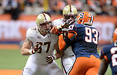 Boston College Eagles offensive lineman Seth Betancourt (67) and tight end C.J. Parsons (87) block defensive end Micah Robinson (93) during a game against the Syracuse Orange at the Carrier Dome on November 30, 2013 in Syracuse, New York.  Syracuse defeated Boston College 34-31.  (Copyright Mike Janes Photography)