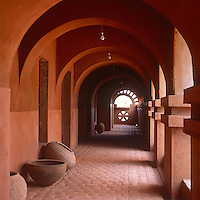 The interior of La Maison Rouge hotel with its distinctive red adobe contruction and Moroccan influence.
