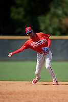 Philadelphia Phillies Christian Valerio (13) throws to first base during a Florida Instructional League game against the New York Yankees on October 11, 2018 at Yankee Complex in Tampa, Florida.  (Mike Janes/Four Seam Images)