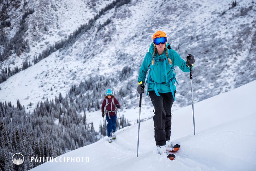 Two women ski touring in the Aksuu Valley, Kyrgyzstan