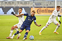 KANSAS CITY, KS - OCTOBER 24: Johnny Russell #7 of Sporting Kansas City with the ball turns his defender during a game between Colorado Rapids and Sporting Kansas City at Children's Mercy Park on October 24, 2020 in Kansas City, Kansas.