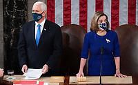 US Vice President Mike Pence, alongside Speaker of the House Nancy Pelosi, presides over a joint session of Congress to count the electoral votes for President at the US Capitol in Washington, DC, January 6, 2021.<br /> Credit: Saul Loeb / Pool via CNP/AdMedia