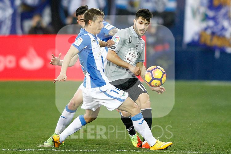 CD Leganes' Alexander Szymanowski (c) and Diego Rico (b) and Deportivo de la Coruna's Carles Gil during La Liga match. February 25,2017. (ALTERPHOTOS/Acero)