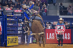 Professional Bull Riders in action during the WinStar Casino and Resort Iron Cowboy bull riding event, at the AT & T stadium in Arlington, Texas.
