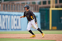 Bradenton Marauders Travis Swaggerty (12) leads off second base during a Florida State League game against the Palm Beach Cardinals on May 10, 2019 at LECOM Park in Bradenton, Florida.  Bradenton defeated Palm Beach 5-1.  (Mike Janes/Four Seam Images)