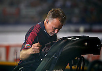 Aug 29, 2014; Clermont, IN, USA; Crew chief Brian Husen guides NHRA top fuel dragster driver Shawn Langdon to the starting line during qualifying for the US Nationals at Lucas Oil Raceway. Mandatory Credit: Mark J. Rebilas-USA TODAY Sports