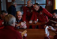 Ski instructors play cards in the morning before people show up for their lessons at Sestriere--Site of the men's downhill skiing during the 2006 Olympics in the Susa Valley west of Turin in the Piedmont.<br /> Siestriere has 800 people off-season but grows to support 30,000.