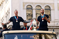 The Italian national team (Francesco Bernardeschi and Leonardo Bonucci) carries the UEFA Euro 2020 cup around Rome on an open bus, welcomed by thousands of supporters. The bus left from piazza Colonna and has reached Piazza Venezia.<br /> Rome (Italy), July 12th 2021<br /> Photo Samantha Zucchi Insidefoto