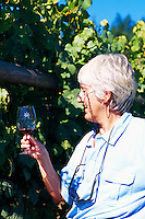 Woman wine tasting at Cherry Point Vineyards, at the Cowichan Valley Wine & Culinary Festival, on Vancouver Island, British Columbia, Canada (Model Released)