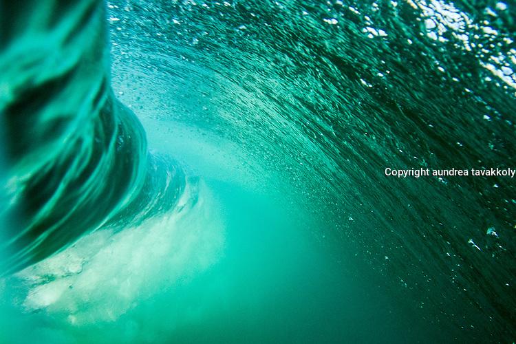 An underwater view of a breaking wave, Zuma Beach, California