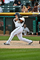 Tommy Field (12) of the Salt Lake Bees at bat against the Albuquerque Isotopes at Smith's Ballpark on April 21, 2014 in Salt Lake City, Utah.  (Stephen Smith/Four Seam Images)