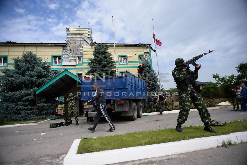 Pro-Russian militia replace Ukrainian flags and guard the perimeter of  the Mirniy Border guard