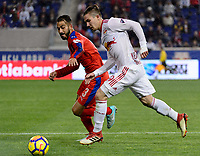 Harrison, NJ - Thursday March 01, 2018: Nicolas Del Grecco, Alex Muyl. The New York Red Bulls defeated C.D. Olimpia 2-0 (3-1 on aggregate) during a 2018 CONCACAF Champions League Round of 16 match at Red Bull Arena.