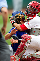 Nick Derba (16) of the Springfield Cardinals gets plowed over by James Cesario (9) of the Tulsa Drillers but still lays down the tag at home plate for the out during a game against the Tulsa Drillers at Hammons Field on June 27, 2011 in Springfield, Missouri. (David Welker / Four Seam Images)