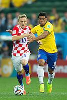 Luka Modric of Croatia and Paulinho of Brazil