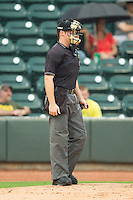 Home plate umpire Junior Valentine calls balls and strikes during the Carolina League game between the Frederick Keys and the Winston-Salem Dash at BB&T Ballpark on July 21, 2013 in Winston-Salem, North Carolina.  The Dash defeated the Keys 3-2.  (Brian Westerholt/Four Seam Images)
