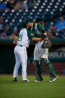 Fort Wayne TinCaps pitcher Jose Quezada (21) and catcher Blake Hunt (12) after closing out a Midwest League game against the Peoria Chiefs on July 17, 2019 at Parkview Field in Fort Wayne, Indiana.  Fort Wayne defeated Peoria 6-2.  (Mike Janes/Four Seam Images)