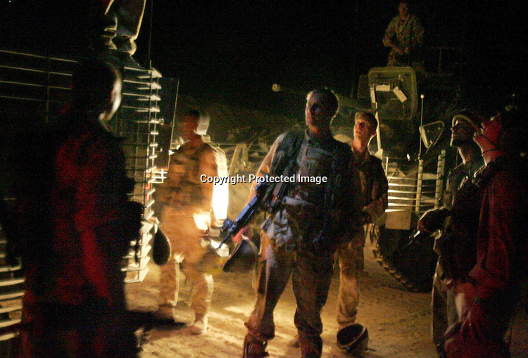 Members of The Staffordshire Regiment laugh and joke after safely completing a night patrol on the streets of Al Amarah in the Maysan Province, north of Basra, in the early hours of 13 October 2005, as part of the increased security just days ahead of the constitutional referendum on 15 October. Three Staffordshire Regiment soldiers were killed by a roadside bomb in Al Amarah in July and the soldiers are still attacked in the street daily. AFP PHOTO / JOHN D MCHUGH