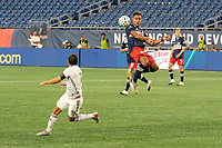 FOXBOROUGH, UNITED STATES - AUGUST 20: Brandon Bye #15 of New England Revolution jumps to head a high cross during a game between Philadelphia Union and New England Revolution at Gilette on August 20, 2020 in Foxborough, Massachusetts.