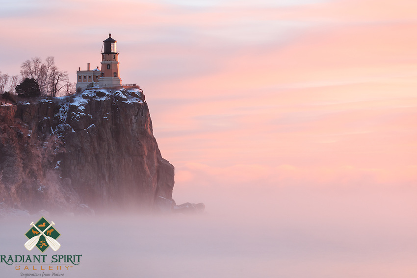 """""""Split Rock Lighthouse in Sea Smoke""""<br /> While at Split Rock Lighthouse, we enjoyed a spectacular sunrise in the subzero sea smoke. The -10°F ambient temps helped paint a gorgeous morning. Upper level clouds reached across Lake Superior while the sea smoke rose silently, only to be whisked away on the breeze to the accumulating clouds at the horizon. As the sun rose, it infused the clouds, sea smoke, and waters in hues of pink. The windchill was invigorating and the warmth of the sun was welcoming."""