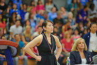 LOS ANGELES, CA - February 5, 2012:  Stanford assistant coach Tabitha Yim during competition against the UCLA Bruins at the Wooden Center.   UCLA defeated Stanford, 197.250 - 196.450.