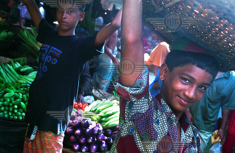 Children working in a fruit and vegetable market.