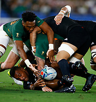 Lukhanyo Am of South Africa looks to to take the ball away from Sevu Reece of New Zealand (All Blacks) during the Rugby World Cup Pool B match between the New Zealand All Blacks and South Africa Springboks at the International Stadium in Yokohama, Japan on Saturday, 21 September, 2019. Photo: Steve Haag / stevehaagsports.com