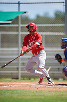 GCL Cardinals designated hitter Angel Moreno (50) follows through on a swing during a game against the GCL Mets on August 6, 2018 at Roger Dean Chevrolet Stadium in Jupiter, Florida.  GCL Cardinals defeated GCL Mets 6-3.  (Mike Janes/Four Seam Images)