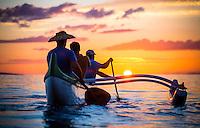 A close focus image of Hawaiian canoe paddlers in a calm ocean at sunset, Lahaina, Maui.