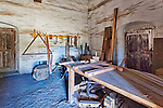 Hositoric carpentry shop with work bench and antique tools, dirt floor and adobe walls, at Mission La Purisima State Historic Park, Lompoc, California.  Mission La Purisima, founded in 1787 by Franciscan Padre Presidente Fermin Francisco Lasuen. La Purisima was the eleventh mission of the twenty-one Spanish Missions established in what later became the state of California.