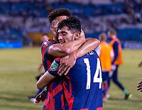 SAN PEDRO SULA, HONDURAS - SEPTEMBER 8: Antonee Robinson #5 and Ricardo Pepi #14 of the United States hug after a game between Honduras and USMNT at Estadio Olímpico Metropolitano on September 8, 2021 in San Pedro Sula, Honduras.