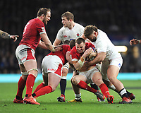 Hadleigh Parkes of Wales is tackled by Will Stuart of England during the Guinness Six Nations match between England and Wales at Twickenham Stadium on Saturday 7th March 2020 (Photo by Rob Munro/Stewart Communications)