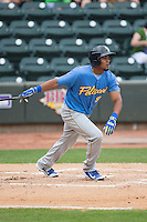 Jeimer Candelario (9) of the Myrtle Beach Pelicans follows through on his swing against the Winston-Salem Dash at BB&T Ballpark on May 10, 2015 in Winston-Salem, North Carolina.  The Pelicans defeated the Dash 4-3.  (Brian Westerholt/Four Seam Images)
