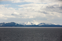 Mountains are pictured across Yellowstone Lake from Steamboat Point in Yellowstone National Park, Wyoming on Monday, May 22, 2017. (Photo by James Brosher)