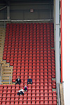Crewe Alexandra 1 Aldershot 2, 09/09/2009. Gresty Road, League 2. Fans of Crewe Alexandra sitting on the main stand watching the players warming up prior to their League 2 fixture against Aldershot Town at the Alexandra Stadium. The visitors won by 2 goals to 1. Photo by Colin McPherson.