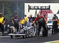Jun. 2, 2013; Englishtown, NJ, USA: NHRA crew chief Brian Husen signals top fuel dragster driver Shawn Langdon during the Summer Nationals at Raceway Park. Mandatory Credit: Mark J. Rebilas-